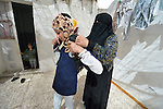 Rufiedah, who asked that her last name not be used for security reasons, prepares her daughter to walk to school in Madaba, a sprawling Palestinian refugee camp in Jordan that has grown in recent years with the arrival of women like Rufiedah, who came to Jordan in 2014 from a village near Damascus, Syria. As a result, the more than 25,000 Palestinians in Madaba have been joined by more than 6,000 Syrians. The  Department of Service for Palestinian Refugees of the Middle East Council of Churches, a member of the ACT Alliance, provides a variety of services here, including medical care.