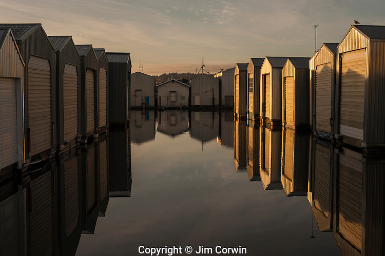Boathouses in rows along the waterfront at Everett Marina