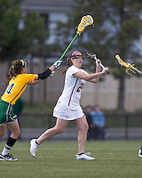 Boston College midfielder Meghan Conley (24) passes the ball. Boston College defeated University of Vermont, 15-9, at Newton Campus Field, April 4, 2012.