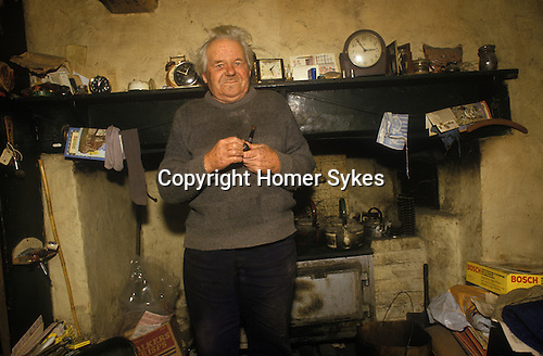Great Tew Oxfordshire 1980s. Local resident Frank Salt who lives in the Toll House.