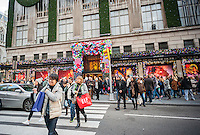 Crowds of shoppers in front of the holiday decorations on Saks Fifth Avenue in Midtown Manhattan in New York on Saturday, November 26, 2016. The National Retail Federation reported that 43.8% of consumers shopped online during the four-day weekend.  (© Richard B. Levine)