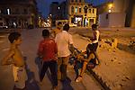 HAVANA, CUBA -- MARCH 24, 2015:   Boys play baseball in Havana, Cuba on March 24, 2015. Photograph by Michael Nagle