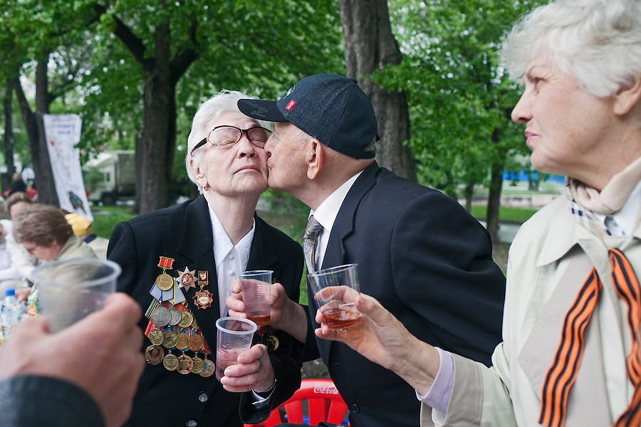Moscow, Russia, 09/05/2012..Two military veterans kiss as Russian World War Two veterans and well-wishers gather in Gorky Park during the countrys annual Victory Day celebrations.