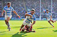 Nicolas Sanchez of Argentina dives for the Tonga try-line. Rugby World Cup Pool C match between Argentina and Tonga on October 4, 2015 at Leicester City Stadium in Leicester, England. Photo by: Patrick Khachfe / Onside Images