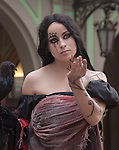 Street Performer holding a fake Raven holding the crowd spellbound with her gaze.