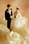 Traditional marriage ceremony, caucasian couple (figurines) on wedding cake, sunset light, Marysville, Washington USA