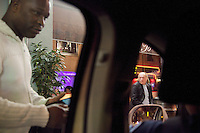 Switzerland. Geneva. A black african man asks a police officer for a street's indication. The policeman is seated in a police car and patrols at night the Paquis neighborhood. 27.03.12 © 2012 Didier Ruef..