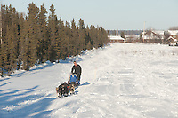 Photographs of John Baker's 2011 Iditarod run. Leaving Kaltag. Stephen Nowers/Alaska Dispatch.