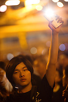 HONG KONG, HONG KONG SAR, CHINA - OCTOBER 01: A demonstrator holds high a lit cellphone to form a 'sea of lights' in Admirality, as part of a pro-democracy sit-in known as 'Occupy Central', blocking traffic on Gloucester Road, an otherwise busy multi-lane thoroughfare in Hong Kong, on October 1, 2014. Now sometimes called the 'Umbrella revolution', the Occupy Central civil disobedience movement began in response to China's decision to allow only Beijing-vetted candidates to stand in the city's 2017 election for the top civil position of chief executive. (Photo by Lucas Schifres/Getty Images)
