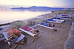 Earthwatchers Sleeping On Cots On Beach At Dawn