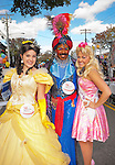 Three teenage acting school students - a boy in Arabian prince costume, girl in yellow gown and girl dressed as Barbie - from the Merrick Theatre & Center for the Arts, at Merrick Street Fair, on Ocotber 22, 2011, Merrick, New York, USA.