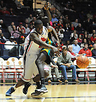 "Mississippi's Reginald Buckner (23) is fouled by Coastal Carolina's El Hadji Ndieguene (11) at the C.M. ""Tad"" Smith Coliseum in Oxford, Miss. on Tuesday, November 13, 2012. (AP Photo/Oxford Eagle, Bruce Newman)"