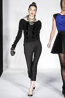 Sanyora walks runway in a bebeBlack Fall 2011 outfit, at the Style 360 Fall 2011 fashion show, during New York Fashion Week.
