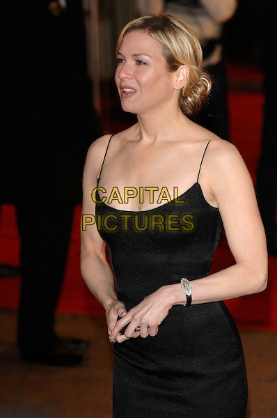 "RENEE ZELLWEGER.""Miss Potter"" World Film Premiere.Empire cinema, Leicester Square.London, England  3rd December 2006 .half length black dress watch.CAP/PL.©Phil Loftus/Capital Pictures"