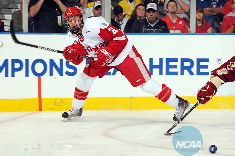 10 APR 2010:  Derek Stepan (21) of the University of Wisconsin passes the puck against Boston College University during the Division I Men's Ice Hockey Championship held at Ford Field in Detroit, MI.  Boston College defeated Wisconsin 5-0 to win the national title game.  Mark Hicks/NCAA Photos