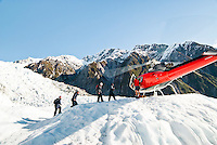 A helicopter's picking up tourists after their guided tour on the Franz Josef Glacier - Westland National Park, West Coast, New Zealand