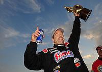 Feb. 12, 2012; Pomona, CA, USA; NHRA pro stock driver Greg Anderson celebrates after winning the Winternationals at Auto Club Raceway at Pomona. Mandatory Credit: Mark J. Rebilas-