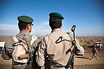 DUZ, IRAQ: A Kurdish peshmerga fighters look over the Hamrin road...Tensions rise in the disputed territories claimed by both the Central Iraqi Government and the semi-autonomous Kurdish region. Kurdish peshmerga fighters and Iraqi soldiers have both been deployed by their respective governments to the disputed territories...Photo by Kamaran Najm/Metrography
