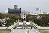 Apr. 05, 2010; Hiroshima, Japan - Springtime in Hiroshima. View of the Cenotaph and the Genbaku Dome and a few cherry blossom trees in full bloom in Peace Park.