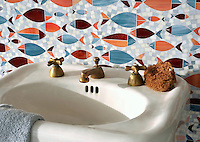 Floating Fish, a glass waterjet  mosaic shown in Mica, Sardonyx, Garnet, Pearl, and Quartz, is part of the Erin Adams Collection for New Ravenna Mosaics.<br />