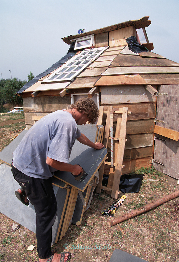 Brendon building his house from skip found  scrap. Wandsworth Eco village.