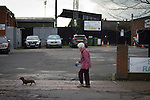 Stafford Rangers 2 Chasetown 1, 26/12/2015. Marston Road, Northern Premier League. A woman with a Dachshund walking past Marston Road, home of Stafford Rangers before they played local rivals Chasetown in a Northern Premier League first division south fixture. The club has played at Marston Road since 1896 and achieved prominence in the 1970s and 1980s as one of England's top non-League teams. League leaders Stafford won this match 2-1, despite having a man sent off, watched by a season's best attendance of 978. Photo by Colin McPherson.