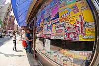 Candy packaging decorates the windows of Economy Candy on Rivington Street in the Lower East Side neighborhood of New York on Saturday, May 26, 2012. Founded in 1937 the family owned business sells an assortment of candy, nostalgic, contemporary and bulk.   (© Frances M. Roberts)