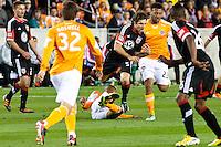 Dejan Jakovic of D.C United, runs over Ricardo Clark of the Dynamo at BBVA Compass Stadium. Houston beat D.C United, 2-0 in the MLS season opener.