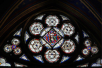 Detail of stained glass window in the bay of the lower chapel of La Sainte-Chapelle (The Holy Chapel), 1248, Paris, France. This smaller windows with a distinctive spherical triangle shape pierces the lower walls of the building. La Sainte-Chapelle was commissioned by King Louis IX of France to house his collection of Passion Relics, including the Crown of Thorns. It is considered among the highest achievements of the Rayonnant period of Gothic architecture. Picture by Manuel Cohen