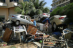 Vehicles and debris that were washed up with the tsunami remain piled up in the parking lot of the Holiday Inn located at the popular tourist destination of Patong Beach on Phuket Island, Thailand, two days after the tsunami ravaged the West Coast of Thailand. On December 26, 2004, a major earthquake generated tsunamis that ravaged coastlines from Southeast Asia to Africa. Approximately 275,000 people were killed and tens of thousands were left homeless, making it one of the deadliest natural disasters in modern history. ..