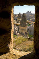 Goreme, Cappadocia, Turkey, July 2005. The views from the chapel are stunning. Dutch Photographer Frits Meyst and his wife Jillian Macdonald restored an old rock house in the village of Goreme. Since Roman Times people have been cutting graves and home out of the Soft tufo 'Fairy Chmney' rocks of Cappadocia. Photo by Frits Meyst / MeystPhoto.com