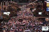 In this Sunday, Jul. 07, 2013 photo, opponents to the ousted president Mohammed Morsi demonstrate in the streets nearby Tahrir Square in Cairo, Egypt. (Photo/Narciso Contreras).
