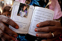 Saida Ali, aged between 65 and 70, lives in the village of Awajah. She has five children and 18 grandchildren. She shows her ID book.