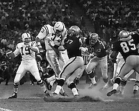 Oakland Raiders vs Baltimore Colts: QBJohnny Unitas is rushed by Ike Lassiter and Carleton Oats,  Ben Davidson (photo by Ron Riesterer)