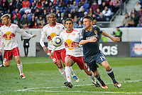 Robbie Keane (14) of the Los Angeles Galaxy and Carlos Mendes (44) of the New York Red Bulls look to play the ball during the 1st leg of the Major League Soccer (MLS) Western Conference Semifinals at Red Bull Arena in Harrison, NJ, on October 30, 2011.