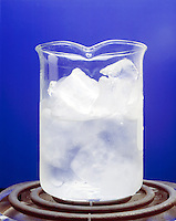 ICE CUBES MELTING IN A BEAKER<br /> (1 of 2)<br /> Water freezes at 0 deg C. or 32 deg F. at 1 atm<br /> Melting ice is favored by entropy but disfavored by enthalpy. The freezing of water is favored by enthalpy but disfavored by entropy. The entropy &amp; enthalpy terms for both processes balance each other at 0 deg C.