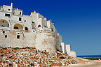 The medieval white fortified hill town walls of Ostuni, The White Town, Puglia, Italy.