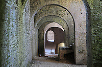 Vaulted gallery of the Bektashi Turbe, the tomb of 2 Bektashi babas, inside the main gate of Kalaja e Gjirokastres or Gjirokastra Castle, built before the 12th century and expanded by Ali Pasha of Tepelene after 1812, Gjirokastra, Albania. The castle dominates the town and overlooks the strategically important route along the river valley. The government of King Zog expanded the castle prison in 1932. Today it has 5 towers and houses, the new Gjirokastra Museum, a clock tower, a church, a cistern and the stage of the National Folk Festival. Gjirokastra was settled by the Greek Chaonians, the Romans and Byzantines before becoming an Ottoman city in 1417. Its old town was listed as a UNESCO World Heritage Site in 2005. Picture by Manuel Cohen