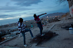 Youth jump on rusted out mattresses in the Diaz Ordaz colonia, one of the poorest neighborhoods of Ciudad Juarez. The group hangs out out a lookout above the neighborhood to see if outside gangs are coming to attack or rob them, after they had recieved death threats and a series of violent exchanges between neighborhoods left them nervous.