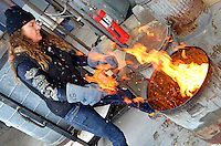 Santa Monica College volunteer Gale McCall demonstrates Raku Firing during the  6th Annual Santa Monica Airport Artwalk on Saturday, March 17, 2012.