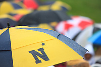 A Navy umbrella among many as spectators watch the 2015 Color Parade during a rain shower at Worden Field in Annapolis, MD.