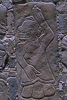 Detail of wall in Sechin, dated 1600 B.C., is one of the oldest and well-preserved of the coastal ruins. Three outside walls of the main temple are covered with relief carvings of warriors and of captives being eviscerated.  The gruesomely realistic stone carvings are up to four meters high.  Little is known about the warlike people who are responsible which is one of the site's main points of interest.