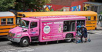 A beverage delivery truck in Chelsea in New York on Wednesday, July 16, 2014  is decorated in pink to show the sponsorship of Crystal Springs bottled water for the Susan G. Komen For the Cure, now known as just Susan G. Komen. breast cancer charity.  (© Richard B. Levine)