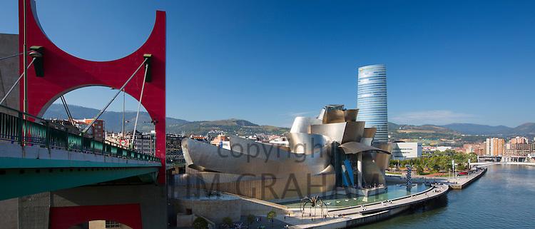 Frank Gehry's Guggenheim Museum, Red Bridge - Principes de Espana Bridge, Iberdrola Tower and River Nervion at Bilbao, Spain