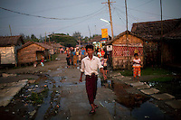A man walks through the Hlaing Thaya slum district of Yangon.