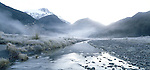 Frost covered river flats with fog and mist layers in the Upper Clarke Valley. Westland Region. New Zealand.