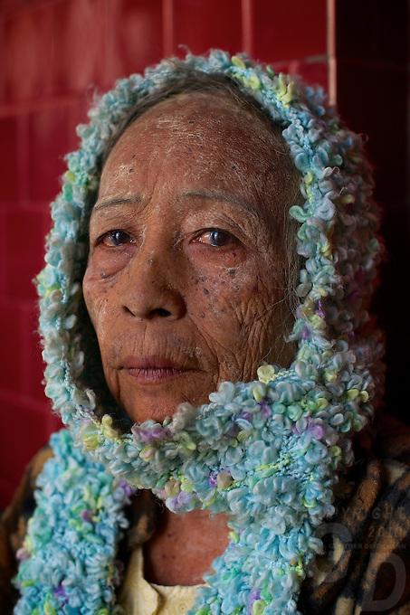 Strange old women at the Maha Muni during Full Moon Festival, Mandalay,  Myanmar, Burma,