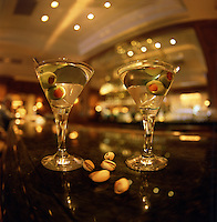 Martini glasses on a bar.