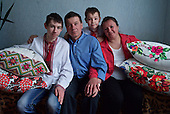 Alexander Pryshchepa, his wife, Tatyana, and their children Alexander and Yuriy at home in Nevhody Village in Ukraine. <br /> <br /> <br /> The village is built to house those affected by the nuclear disaster in the Chernobyl power station disaster happened on 26 April 1986. <br /> <br /> The parents and children all suffer from multiple health problems linked to radiation exposure. <br /> <br /> The pillow cases, handwoven by Alexander senior's mother, is the only souvenir they could take from their old home. <br /> <br /> 30 years on, the area is still too heavily contaminated for human activity.