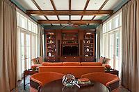 The Club Room is warm with orange and turquoise tones creating a cozy TV<br /> space